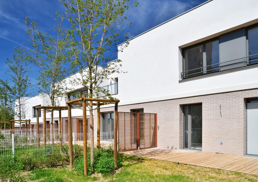 Les maisons depuis les jardins privatifs
